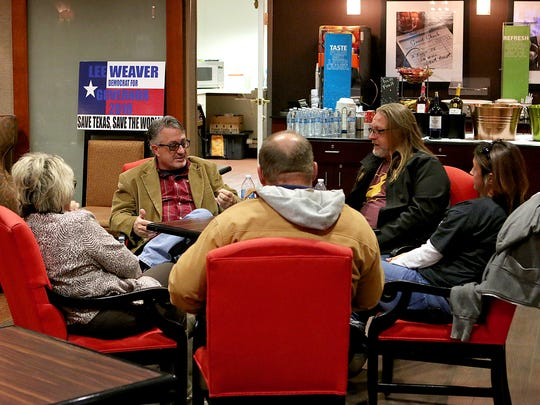 Former Wichitan Lee Weaver talks with prospective voters during a political fundraiser and meet-and-greet event at the Hampton Inn, 4217 Kemp Blvd., Friday evening. Weaver is aiming to run for Texas governor.