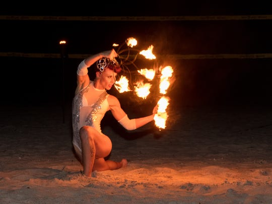 Fire dancer delights the crowd.