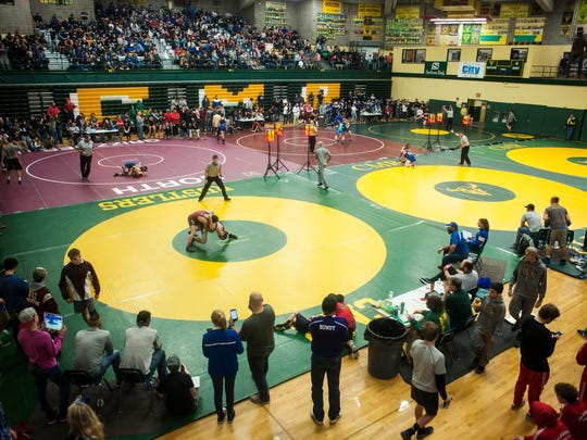 Prep wrestling rankings, college scores from Wednesday night.