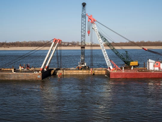 Efforts to salvage the large towboat that sunk deep into the Mississippi River have moved forward this week as workers managed to start attaching chains to the vessel, a spokesman for the boat company said.