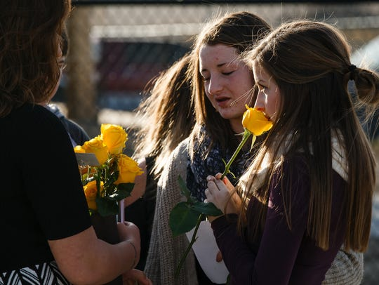 Classmates of Megan Mae Klindt talk after memorial