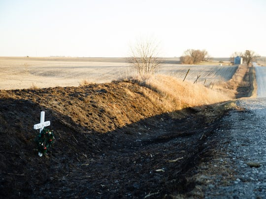 A memorial sits on the side of the road where Megan