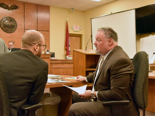Brandon Elkins, left a TBI Special Agent talks with Scott County Assistant Attorney General David Pollard, right at a hearing for Billy James Carson Monday December 18, 2017.  Carson a food vendor accused of a vehicular rampage through a crowd of patrons at a country music concert in Scott County killing Indiana monster truck driver Tony Farrell.  Carson entered a guilty plea to Vehicular Homicide and 5 other counts before Scott County Criminal Court Judge Shayne Sexton.
