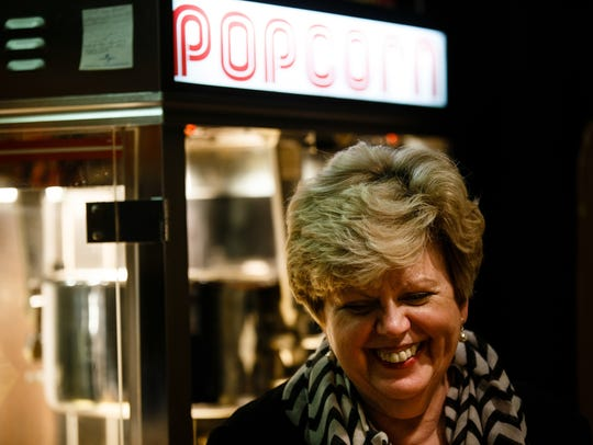 Denise Mahon scoops popcorn before a show at the Varsity