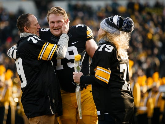 Before playing his final home game at Kinnick Stadium on Nov. 18, 2017, Sean Welsh greets his parents, Matt and Deb.