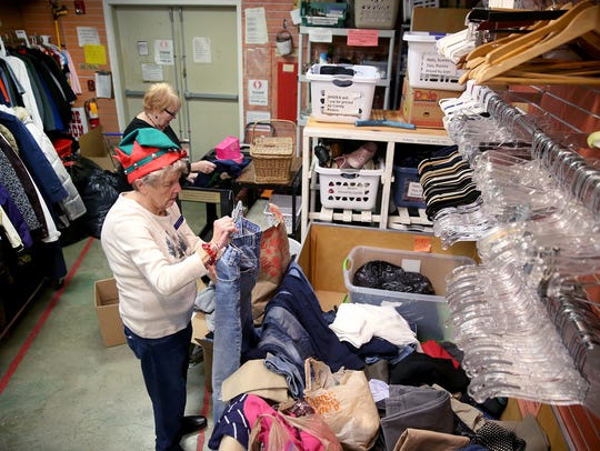 Eleanor Morrison, a volunteer at North Kitsap Fishline's Second Season Thrift Store, sorts through the donations bins in the cramped Anderson Parkway store. The store is moving into a larger space in the Poulsbo Village shopping center.