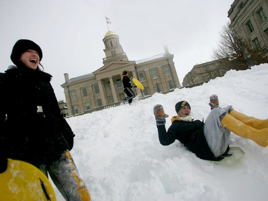 University of Iowa freshmen living in Burge Residence Hall grabbed lunch trays Feb. 2 and headed for the Pentacrest to go sledding. Benjamin Roberts / Iowa City Press-Citizen PC Photo by Benjamin Roberts UI freshman at Burge residence hall grabbed lunch trays and headed for the Pentacrest on Wednesday, February 2, 2011.