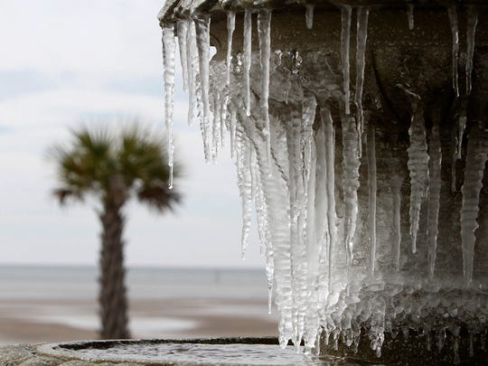 Icicles hang from the fountain in Biloxi, Miss., on Monday, Jan. 1, 2018. A hard freeze hit South Mississippi overnight and temperatures are expected to remain near or below freezing for the rest of the week.