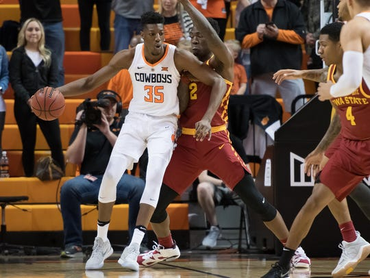 Oklahoma State Cowboys forward Yankuba Sima (35) fights