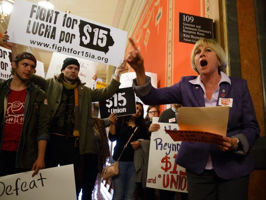 Iowa democratic candidate for governor Cathy Glasson speaks during a rally for a $15 minimum wage and unions after Gov. Kim Reynolds addressed the Iowa Legislature during her first Condition of the State address on Tuesday, Jan. 9, 2018, in Des Moines.