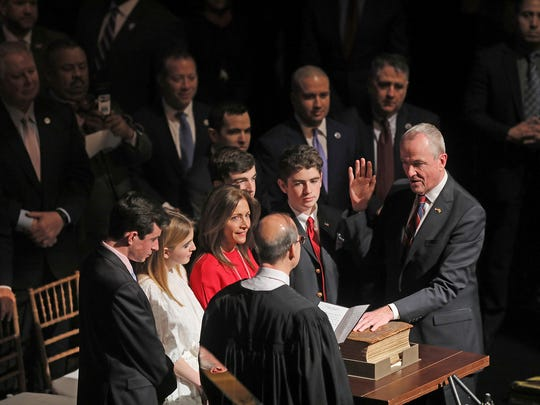 Chief Justice Stuart Rabner swears in Phil Murphy as New Jersey governor last month in front of the Murphy family. He is using the Bible used to swear in President John F. Kennedy.
