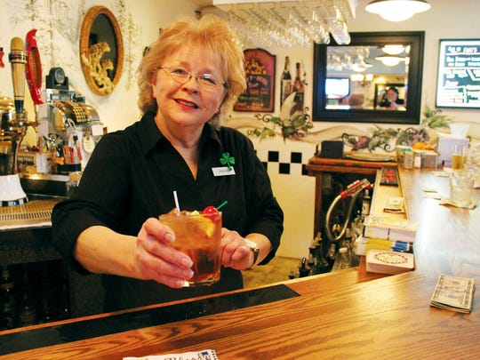 Trish Lenarchich serves one of the staples of a Wisconsin supper club, a brandy old fashioned, at the Stoneridge Inn.