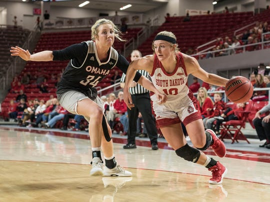 Allison Arens drives around Omaha's Ellie Brecht during
