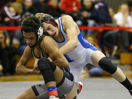 Elmira's Blake Brooks, right, wrestles Horseheads' Latimer Audinwood in the 106-pound final of the Southern Tier Athletic Conference tournament Saturday at Chenango Valley. Brooks won in overtime.