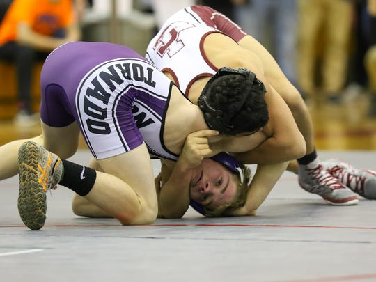 Johnson City's Dante Rigan, top, controls Norwich's Dante Geislinger in the 99-pound final of the Southern Tier Athletic Conference tournament Saturday at Chenango Valley. Geislinger pinned Rigal in the third period.