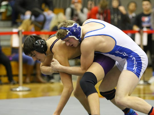 Horseheads graduate Chris Eames, top, is wrestling for Brockport this season.