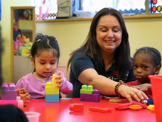 One of the rooms in the new childcare center at the Somerset Community Action Program in Franklin. Teacher Evelyn Enamorado interacts with Carolina Martinez, left, and Messiah Negron on Friday, Jan. 19.