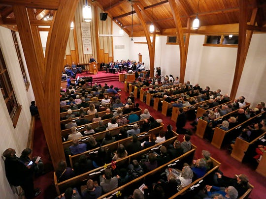 "A standing room only crowd squeezes into the sanctuary for ""Stand for Love, Sing for Justice"" : Affirmation of Freedom Thursday, January 24, 2018, at the Unitarian Universalist Church in West Lafayette. The event, which featured several speakers and singing, was in response to recent racist and homophobic vandalism at the church."