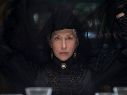 """This image released by CBS Films shows Helen Mirren in a scene from """"Winchester."""" Mirren says her latest film isn't really a horror film, but rather a ghost story with a very distinct American element. The 72-year-old Oscar winner plays Sarah Winchester, a heiress who inherited a massive fortune from her husband's invention of the Winchester repeating rifle after the Civil War. In the film, Winchester is haunted by the people killed by the famous firearm. (Ben King/CBS Films via AP)"""