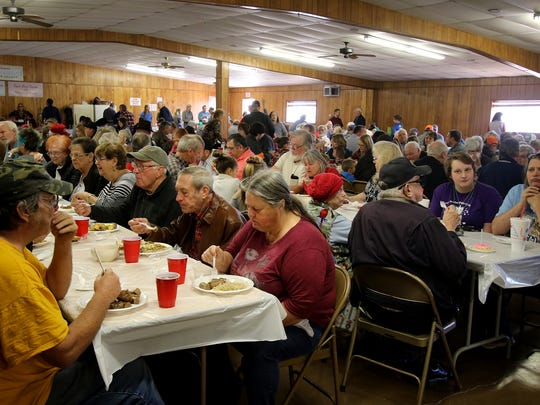People eat their fill of sausage, green beans, corn, mashed potatoes and sauerkraut during the annual Scotland Sausage Feed Sunday, Feb. 4, 2018, at the Scotland Knights of Columbus hall.