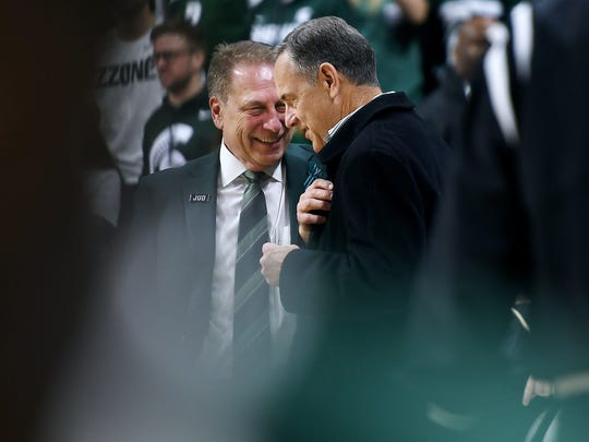 MSU basketball coach Tom Izzo, left, and football coach Mark Dantonio, shown here together last February, have created one of the better 1-2 punches in the country in terms of football and hoops.