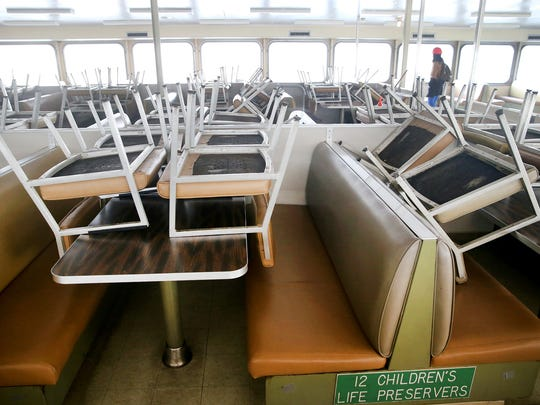 Stacked up passenger chairs on the 50-year-old, gold stripe-clad state ferry Hyak.