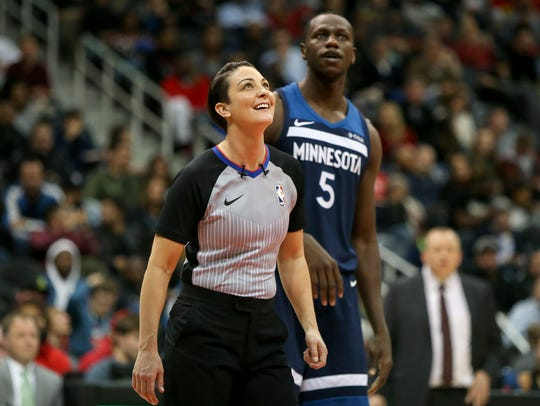 Referee Lauren Holtkamp (7) talks to Minnesota Timberwolves