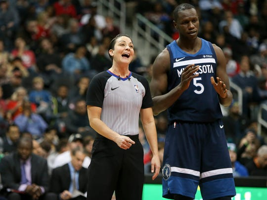 Referee Lauren Holtkamp (7) talks to Minnesota Timberwolves center Gorgui Dieng (5) against the Atlanta Hawks in the third quarter at Philips Arena.