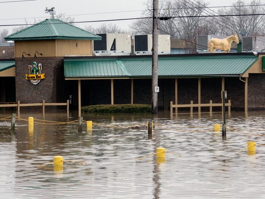 Flood water surrounds the Green Dot Stables restaurant