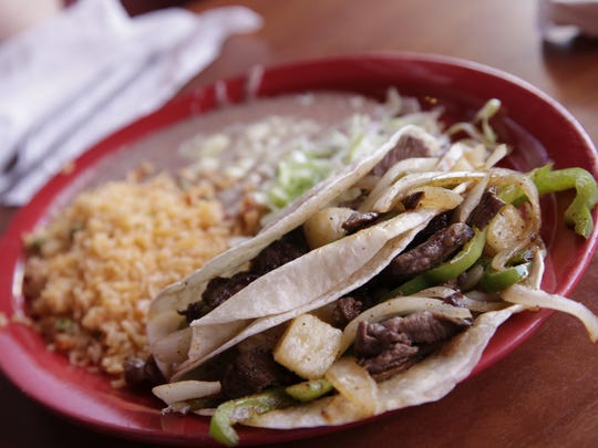 The Hawaiian tacos at La Hacienda come with a side of beans and rice. Eric Rowley/Juice The Hawaiian Tacos at La Hacienda in Des Moines comes with a side of beans and rice. Eric Rowley/Juice