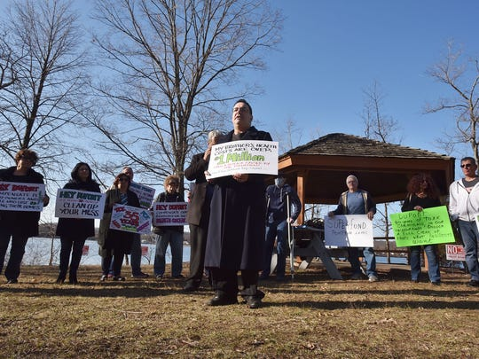 Pompton Lakes resident Jefferson Harman LaSala demands a cleanup of DuPond at a press conference organized by the residents.