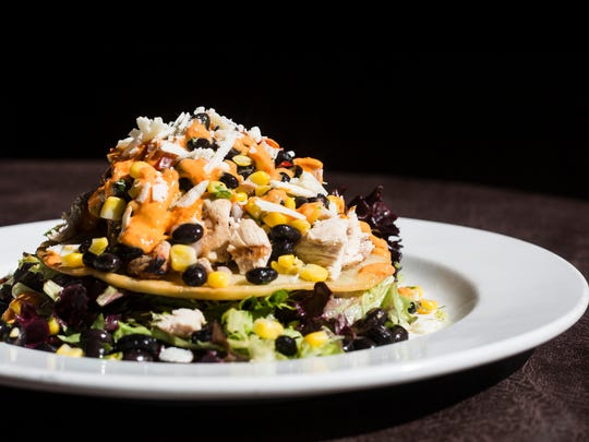 February 26, 2018 - Grilled chicken tostada with black bean corn relish, red pepper creme fraiche and queso fresco, served over greens, with chipotle lime vinaigrette at McEwen's in downtown Memphis. McEwen's turned 20 in November.