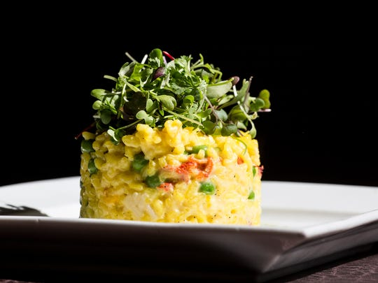 February 26, 2018 - Saffron lobster risotto featuring sweet lobster, green peas and fresh grated parmesan at McEwen's in downtown Memphis. McEwen's turned 20 in November.