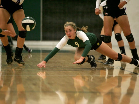 West High junior Caroline Found dives against C.R.