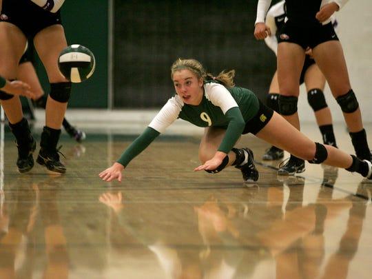 West High junior Caroline Found dives against C.R.