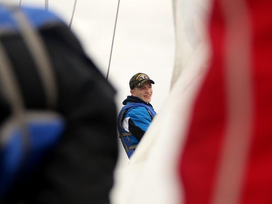 South Kitsap student Logan Destrada and other Lively crew members prepare to raise the sails on Friday during a cruise in Sinclair Inlet. He and other cadets South Kitsap's Naval Junior Reserve Officer Training Corps learn seamanship and leadership on the school-owned boat.
