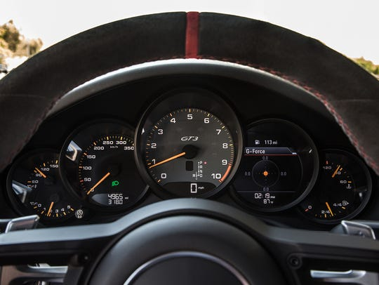 The cockpit of the 911 GT3 is all business, featuring a centrally mounted tachometer boasting a redline that pushes 9,000 rpm.
