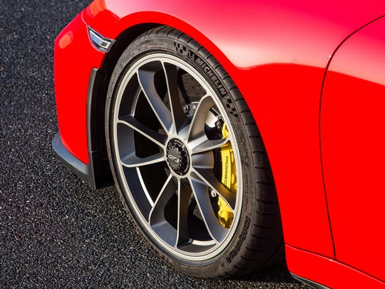 The Porsche 911 GT3 features massive 20-inch wheels and hydraulic brake assist to better slow the car from its 197 mph top speed.