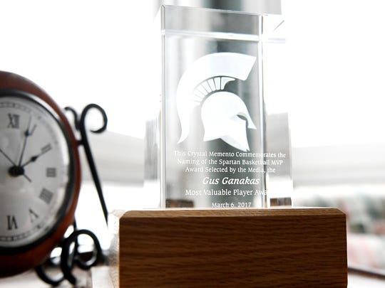 A memento commemorating the naming of the Spartans basketball MVP award after former MSU basketball coach Gus Ganakas sits on display at his home in East Lansing. Players vote on the award each season.
