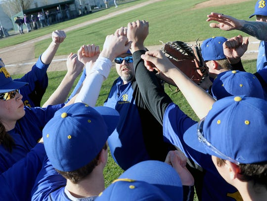 Bremerton baseball coach Steve Dickey (center) helped South Kitsap win a state title in 2015. Dickey served as the Wolves' pitching coach from 2013-2017.