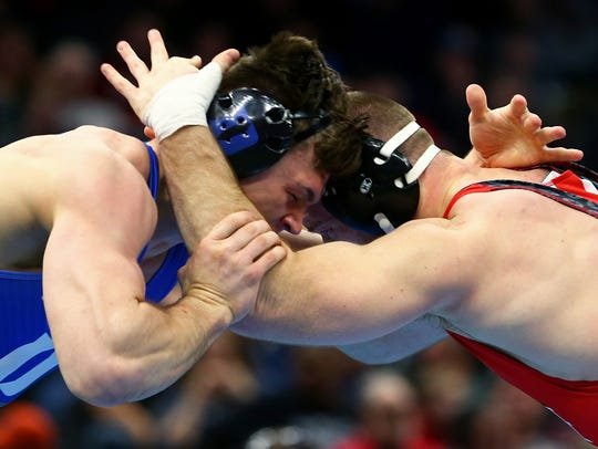 Lexington grad Jacob Kasper, a two-time All-American for Duke,  (left) battles Ohio State's Kyle Snyder in the heavyweight semifinals at the NCAA Championships.