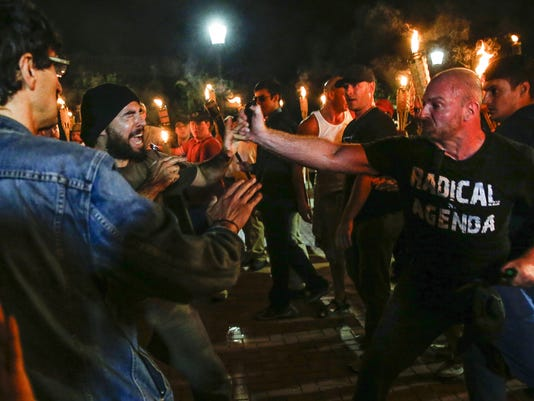 News: White nationalists, counter protesters feud in Charlottesville after nationalits hold torch march through UVA campus