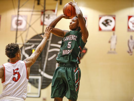 Lawrence North Wildcats Jared Hankins (5) goes up and