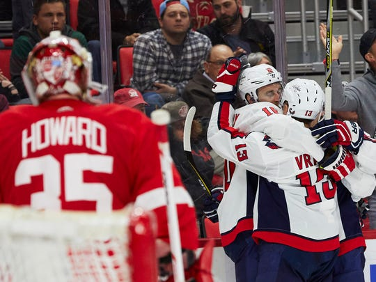 Capitals right wing Brett Connolly (10) receives congratulations