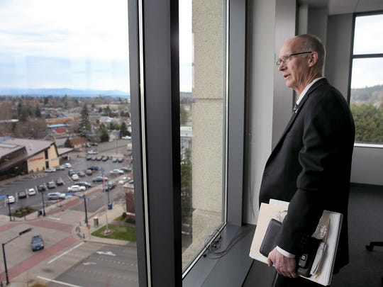 City of Bremerton Public Works and Utilities director Chal Martin looks at the view from the corner conference room on the fifth floor of the Norm Dicks Government Center. Martin was fired Tuesday after an internal city investigation.