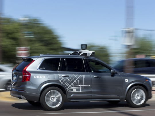 A self-driving Uber vehicle cruises in Tempe, Ariz., on Aug. 25, 2017. A self-driving Uber vehicle hit and killed a woman Sunday, March 18, 2018.