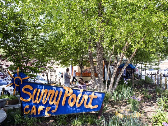 Sunny Point Cafe in West Asheville, which opened in 2003, is aware that parrots are not allowed inside. A new staffer made a mistake in allowing a pair of the birds in the dining area.