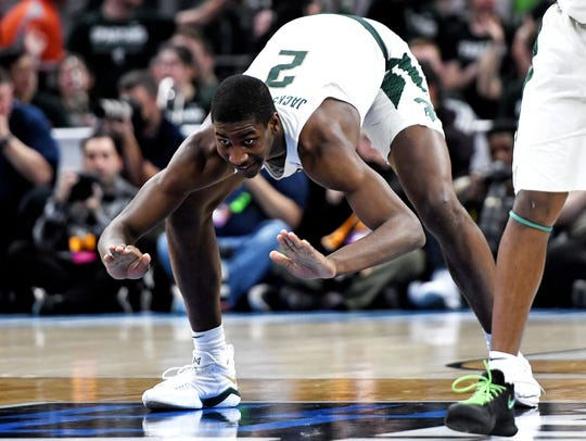 Michigan State's Jaren Jackson Jr. slaps the floor