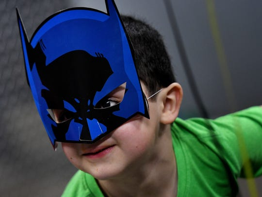 Five-year-old Vincent Gentile wears a Batman mask during