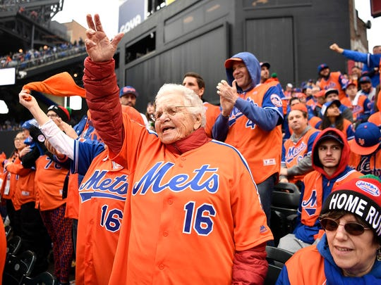 Elaine Zimbler of New York City cheers for the Mets with the rest of the 7 Line Army during the Opening Day game